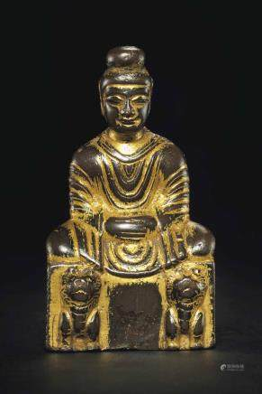 A SMALL GILT-BRONZE FIGURE OF SHAKYAMUNI BUDDHA
