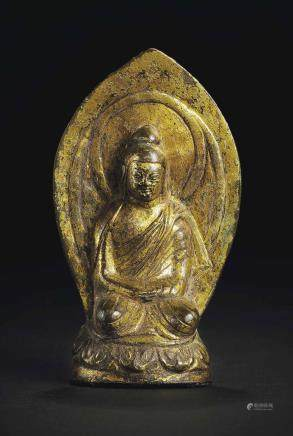 A GILT-BRONZE FIGURE OF SHAKYAMUNI BUDDHA