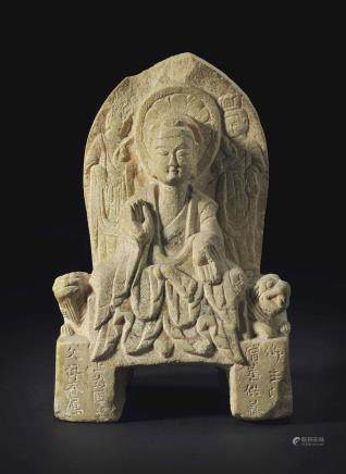A STONE STELE OF BUDDHA AND ATTENDANTS