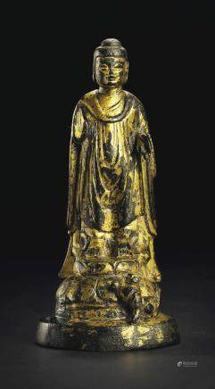 A SMALL GILT-BRONZE STANDING FIGURE OF BUDDHA
