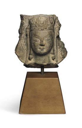 A SMALL STONE HEAD OF A BODHISATTVA