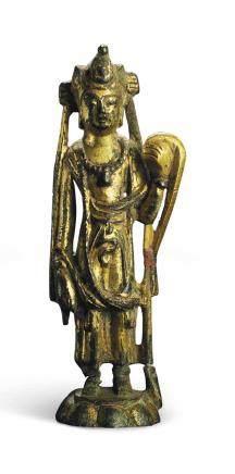 A SMALL GILT-BRONZE STANDING FIGURE OF A BODHISATTVA