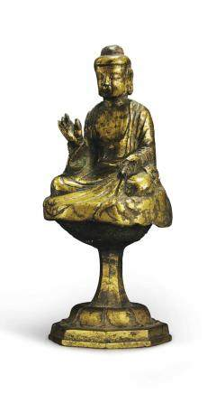 A GILT-BRONZE SEATED FIGURE OF BUDDHA