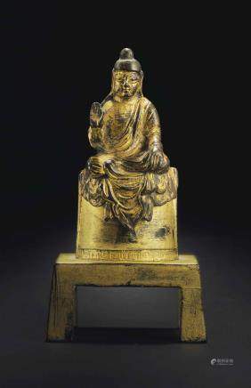 A SMALL GILT-BRONZE SEATED FIGURE OF BUDDHA