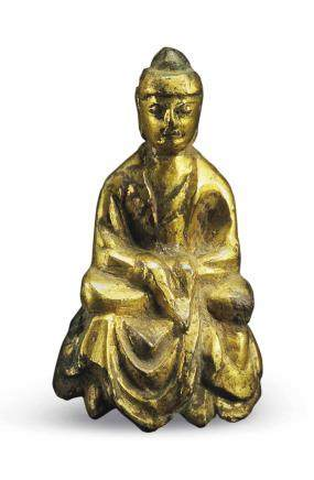 A MINIATURE GILT-BRONZE SEATED FIGURE OF BUDDHA