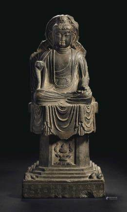 A GREY STONE SEATED FIGURE OF BUDDHA