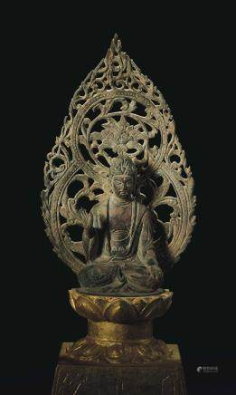 A RARE BRONZE SEATED FIGURE OF BUDDHA