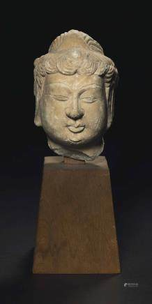 A SMALL WHITE MARBLE HEAD OF A BODHISATTVA