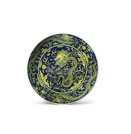 AN UNDERGLAZE-BLUE AND YELLOW-ENAMELED 'DRAGON' DISH QIANLONG SEAL MARK AND PERIOD