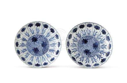 A PAIR OF BLUE AND WHITE 'ASTER' DISHES KANGXI MARKS AND PERIOD