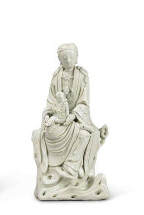 A DEHUA FIGURE OF GUANYIN AND CHILD QING DYNASTY, 19TH CENTURY