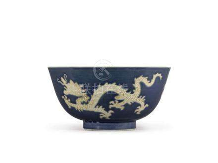 A BLUE-GROUND 'DRAGON' BOWL QING DYNASTY, KANGXI PERIOD