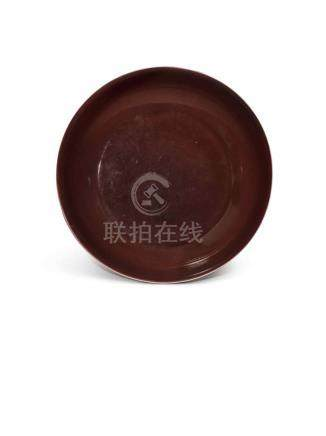 A COPPER-RED GLAZED DISH QIANLONG SEAL MARK AND PERIOD