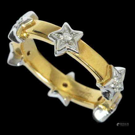 AN 18K WHITE AND YELLOW GOLD RING