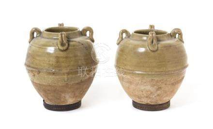 A Pair of Green Glazed Pottery Jars