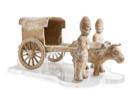 A Pottery Model of an Ox Cart  with Two Standing Attendants