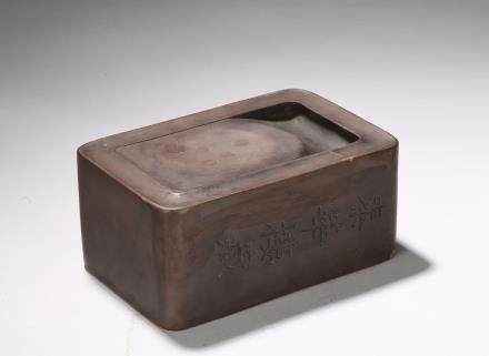 A rectangular and inscribed inkstone