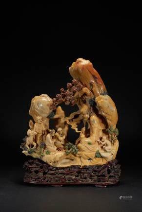 A Shoushan carved Taoist figure boulder