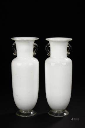 A pair of white and clear glass rouleau bottles