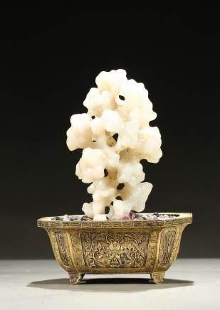 A white jade scholar's rock w/ gilt-bronze jardiniere