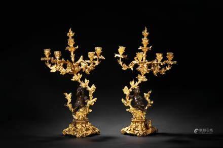 A pair of large European gilt candlesticks