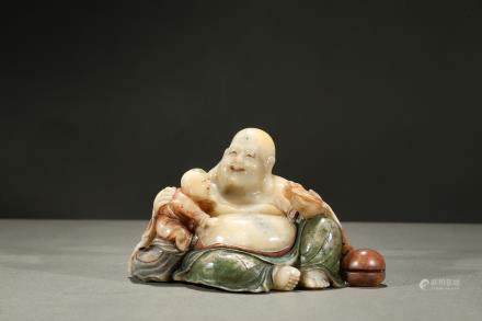 A painted soapstone carving of luohan