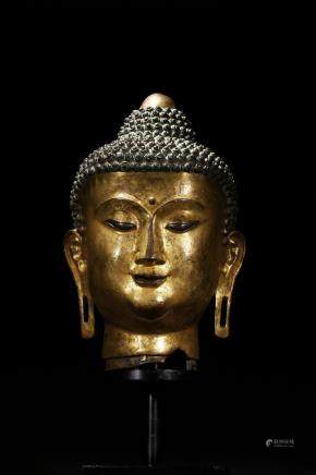 A large gilt-bronze head of bodhisattva