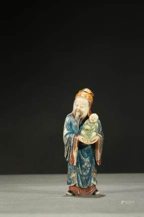 A painted soapstone carving of lu star