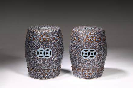 A pair of large Yixing zisha painted stools
