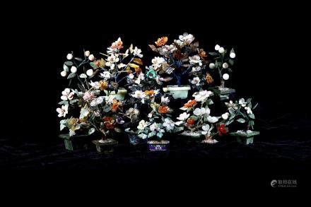 A group of jade and agate flower jardinieres