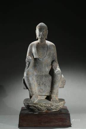 A stone carving of seated shakyamuni
