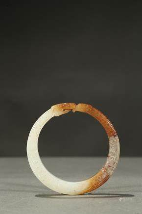 A white and russet bangle