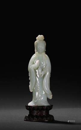 A white jade figure of standing Guanyin