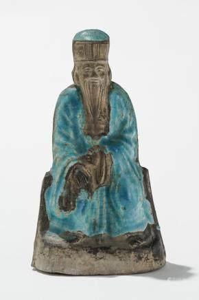Statuette, Chine, probablement XVIIe s  Grès partiellement émaillé turquoise, représentant un dignitaire assis, H 18 cm