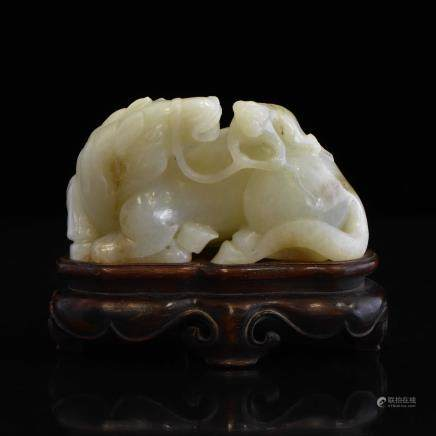 CARVED CELADON JADE OF MONKEY ON A HORSE