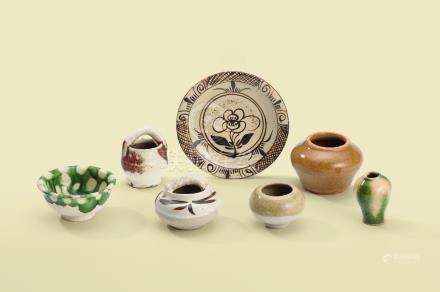 A GROUP OF SEVEN GLAZED MINIATURE VESSELS