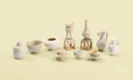 A SET OF FOUR SMALL WHITE-GLAZED MINIATURE VESSELS, A SET OF FIVE QINGBAI MINIATURE ALTAR VESSELS AND A DING-TYPE MINIATURE ALMS BOWL