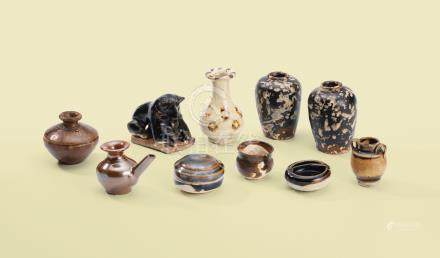 A GROUP OF TEN BROWN-GLAZED MINIATURE STONEWARE VESSELS