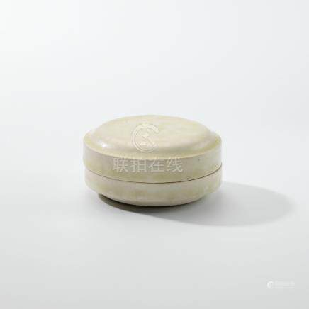 A SMALL WHITE-GLAZED CIRCULAR BOX AND COVER