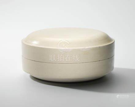 A LARGE WHITE-GLAZED FLATTENED CIRCULAR BOX AND COVER