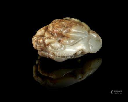 A rare white and russet jade 'lion head' fitting