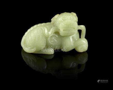 A yellow jade carving of a Buddhist lion