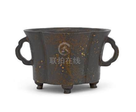 A bronze quatrefoil incense burner
