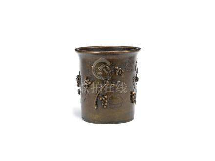 A bronze 'squirrel and grapes' brushpot