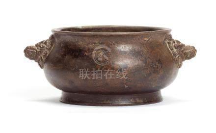 A small bronze incense burner