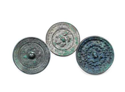 Three archaic bronze 'mythical beasts' mirrors