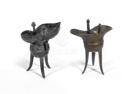 Two bronze tripod vessels, jue