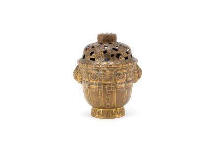 A gilt-bronze incense burner and cover