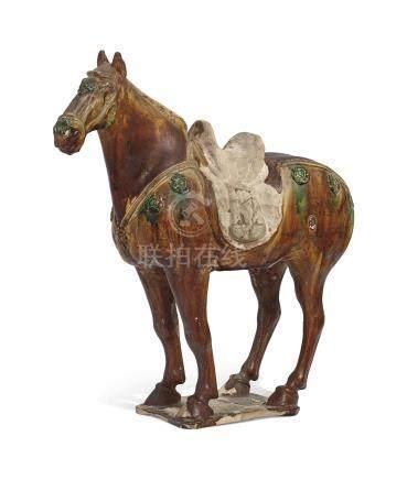 A SANCAI- GLAZED POTTERY FIGURE OF A HORSETANG DYNASTY (AD 618-907)