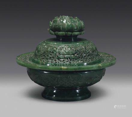 A SPINACH GREEN JADE 'EIGHT BUDDHIST EMBLEMS' FLORAL CENSER AND COVER18TH-19TH CENTURY